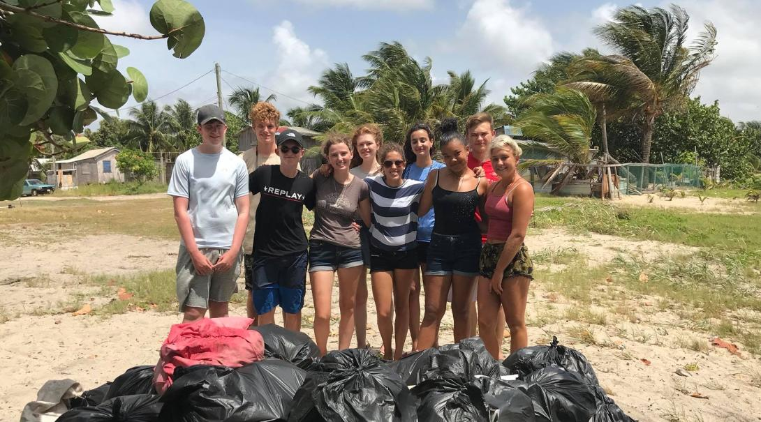Projects Abroad volunteers helped cleaning the beach in Belize as part of their marine conservation efforts to keep the ocean clean.